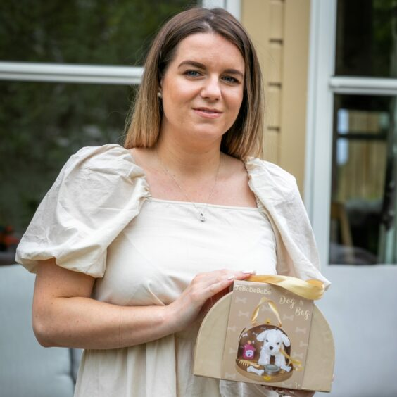 Amanda Cramb holding a toy from online shop Annie's Accessories.