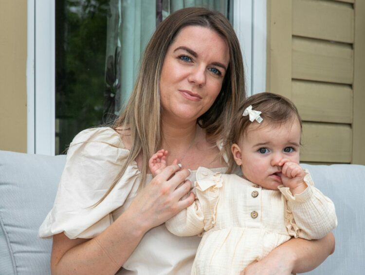 """Amanda Cramb's """"little miracle"""" Annie inspired her to start online baby shop Annie's Accessories."""
