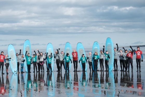 Young people and volunteers from The Wave Project.