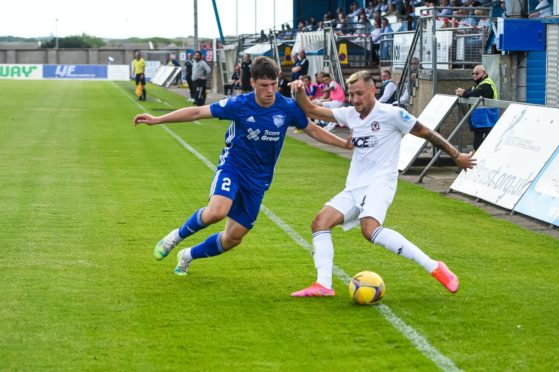 Peterhead's Josh Mulligan in action against Cove Rangers' Connor Scully.