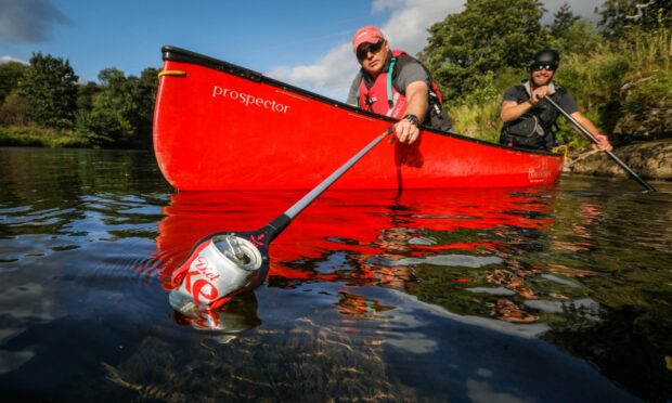 Keep Scotland Beautiful CEO Barry Fisher and volunteers from Beyond Adventure are taking part in the Upstream Battle campaign.