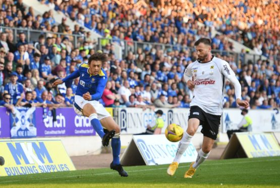 St Johnstone's Murray Davidson crosses the ball in front of a packed stand during a Europa Conference Qualifier between St Johnstone and LASK at McDiarmid Park on August 26, 2021.