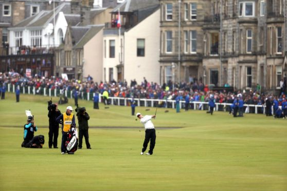 Zach Johnson of the United States tees off on the first hole of the Old Course during the Open in 2015.