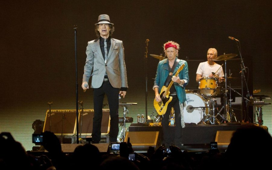 Mick Jagger, Keith Richards and Charlie Watts perform at the O2 in London to celebrate their 50th anniversary.