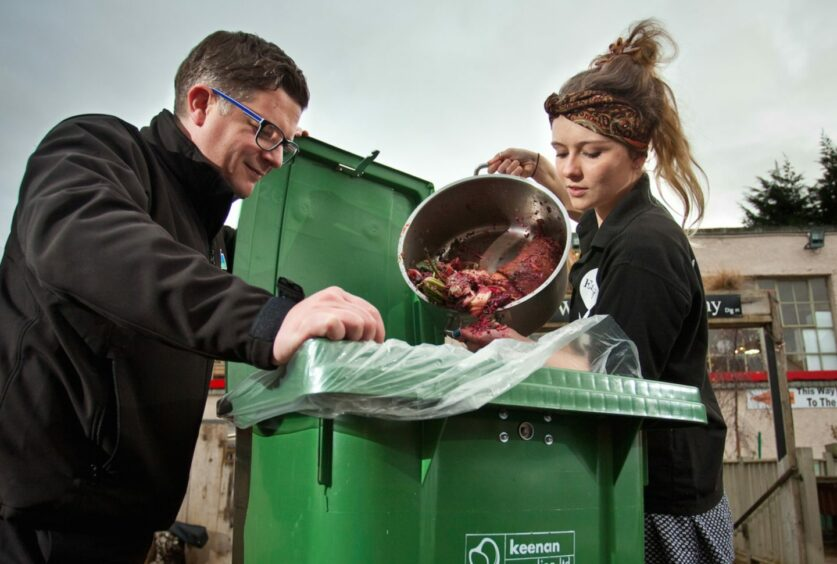 Andrew Gerlach from Keenan Recycling in Aberdeen helps a cafe owner deal with their food waste.