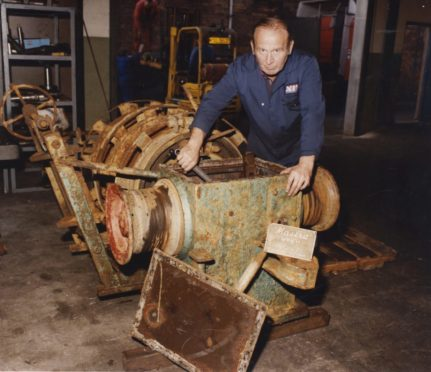 Bill Birse, an engineer with Northern Tool and Gear Co Arbroath, with the winch from the fishing boat, Antares, pictured in 1991.