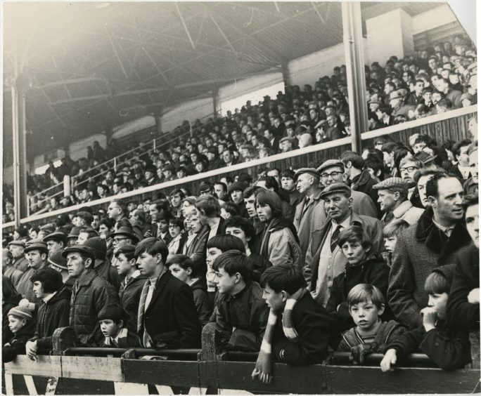 The crowd at Muirton Park watch on during a game between St Johnstone and Aberdeen in 1971.