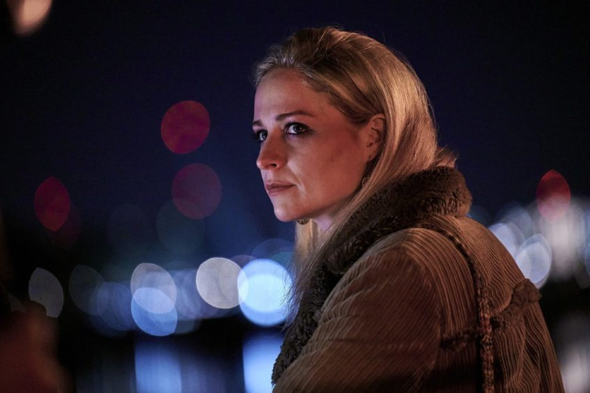A scene from deceit showing actress Niamh Algar portraying undercover police officer Lizzie James.