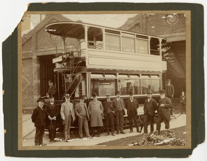Tramway officials and staff pose by the first tram to leave the Maryfield depot.