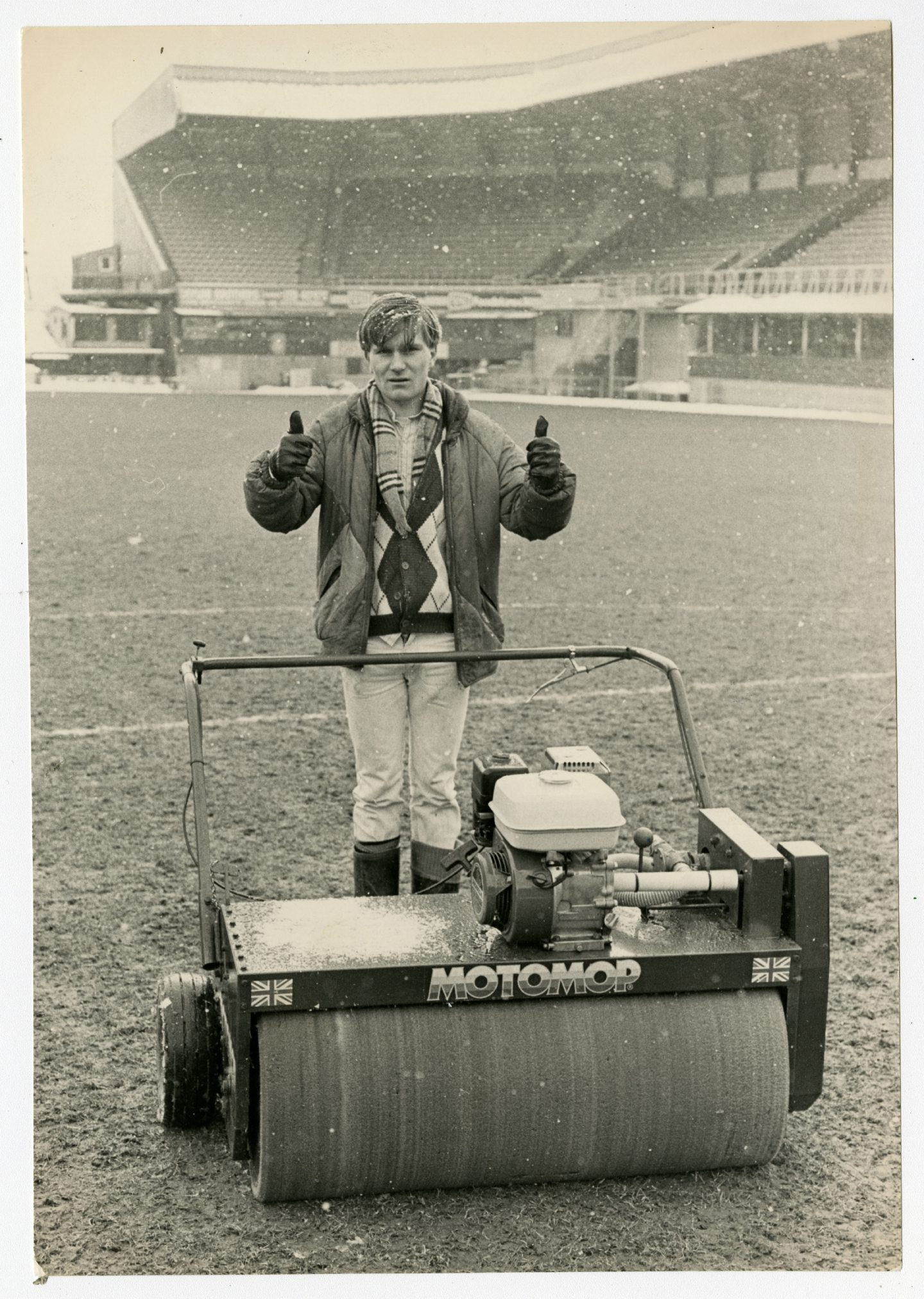 Tannadice groundsman James Fox giving the thumbs up after going over the the pitch with the club's motomop in February 1986.
