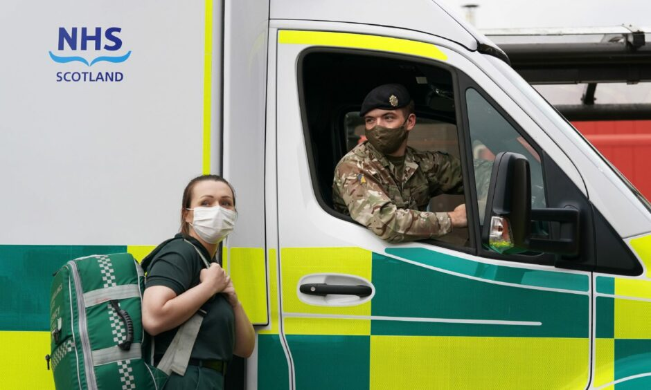 Scottish Ambulance Service Paramedic Amy Young alongside Private Guy Spiers from 68 Squadron of 7th Regiment Royal Logistic Corps.