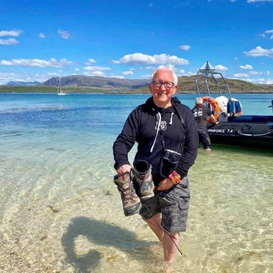 Dundee man Jim Smyth during a fast boat trip to the island of Canna this summer.