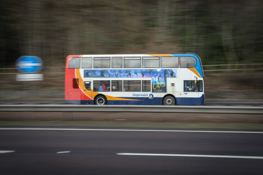 A Stagecoach bus driving down a dual carriageway