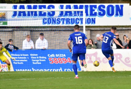 Cove Rangers striker Rory McAllister rolls home the penalty.