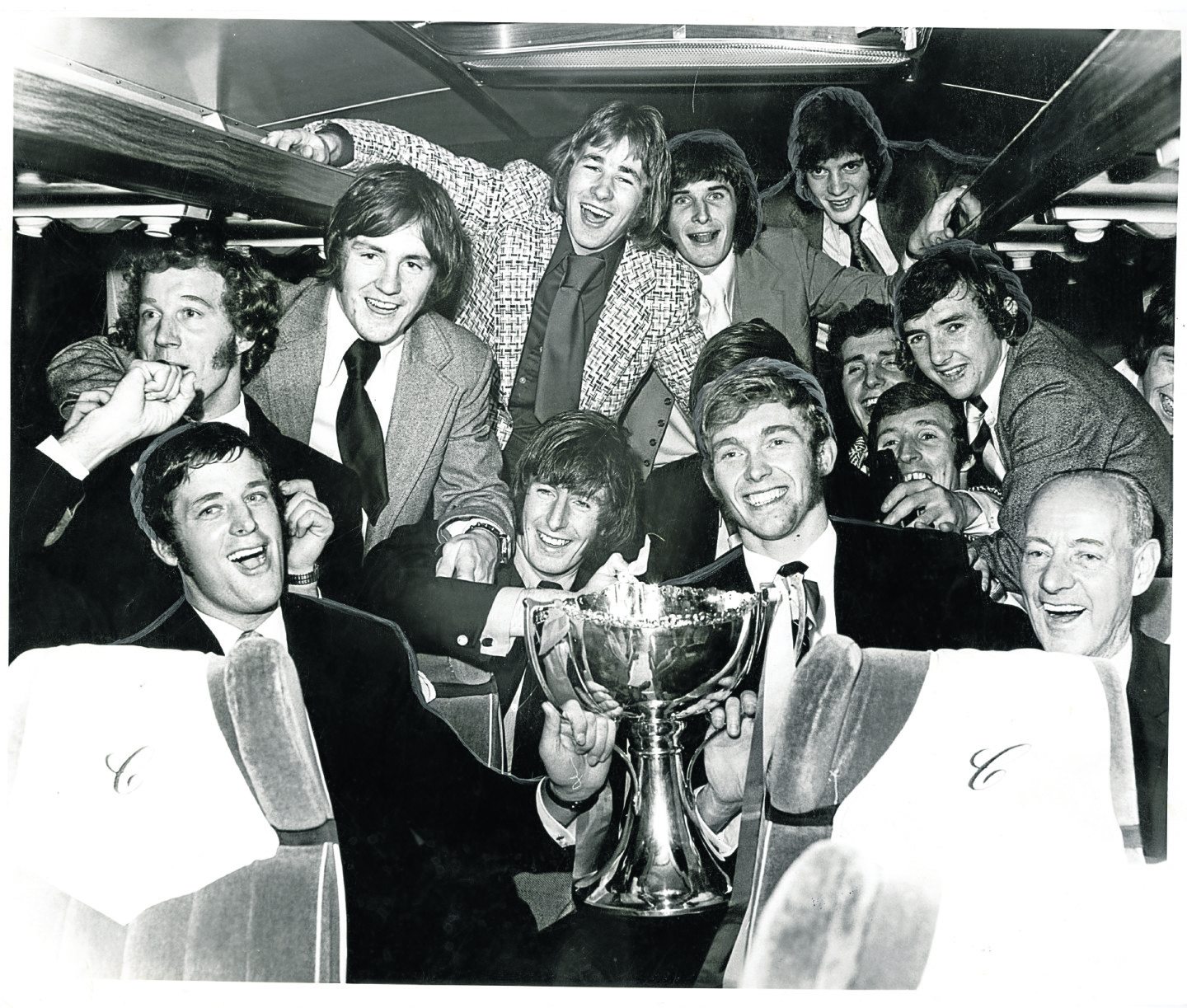 The Partick Thistle players in a happy mood on the bus after their win, with Alan Rough pictured at the back on the left.