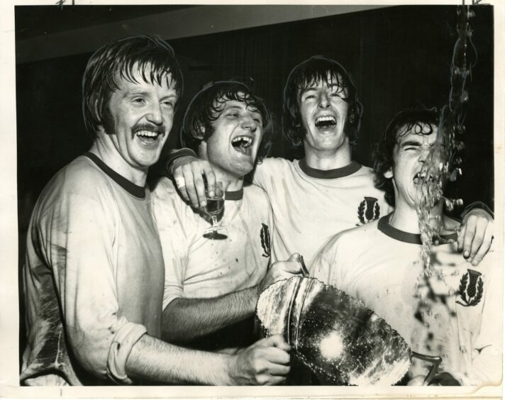 Partick Thistle's goalscorers - Alex Rae, Jimmy Bone, Dennis McQuade and Bobby Lawrie - hold the Scottish League Cup.