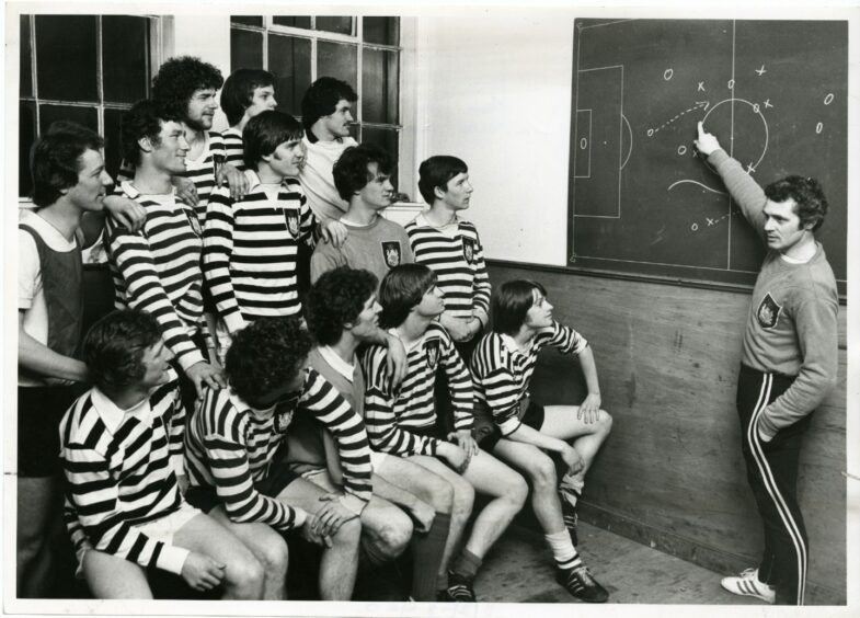 Doug Wilkie and the Queen's Park squad being schooled by manager Joe Gilroy in 1978.