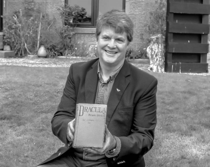 Dacre Stoker with Bram Stoker's personal copy of Dracula, written in 1897.