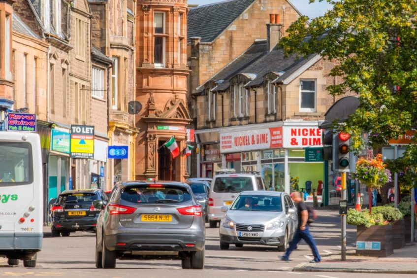 Crieff High Street, one of Tayside and Scotland's worst offenders for air pollution, busy with cars