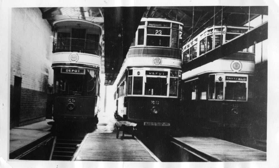 Trams sit inside the Maryfield depot in August 1965.