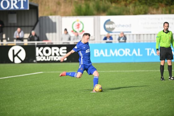 Mitch Megginson dispatches the winning penalty.