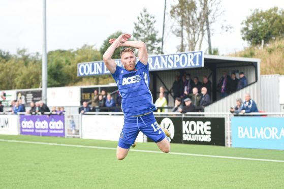 Rory McAllister takes off during his celebration.