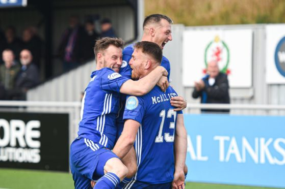 Cove Rangers' goalscorer Rory McAllister is congratulated by Mitch Megginson and Connor Scully.