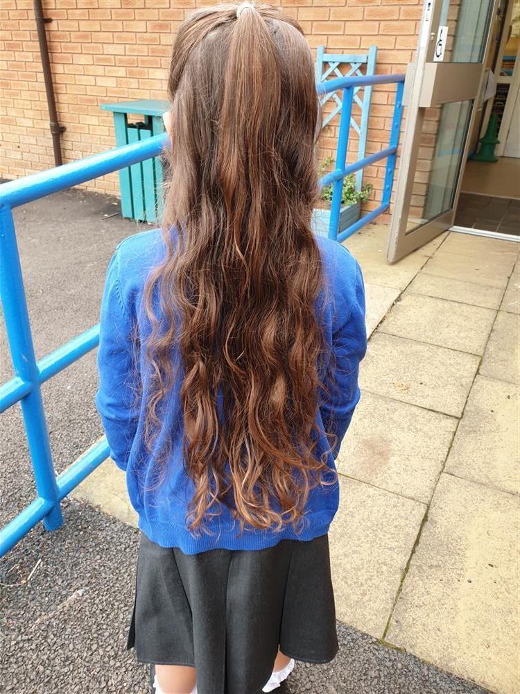Strathmartine primary pupil Alix's long hair.
