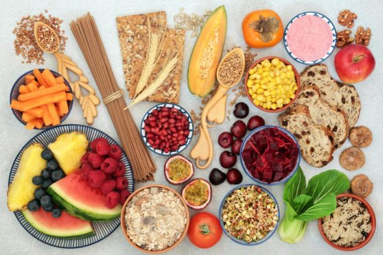 An image showing a plethora of fruit and grains - all the best food to get fibre