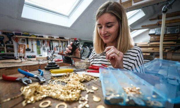 Jane in her workshop creating Paper People jewellery.