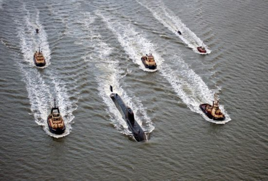 The new submarine HMS Astute heading to her homeport of Faslane on the Clyde in Scotland in 2009.