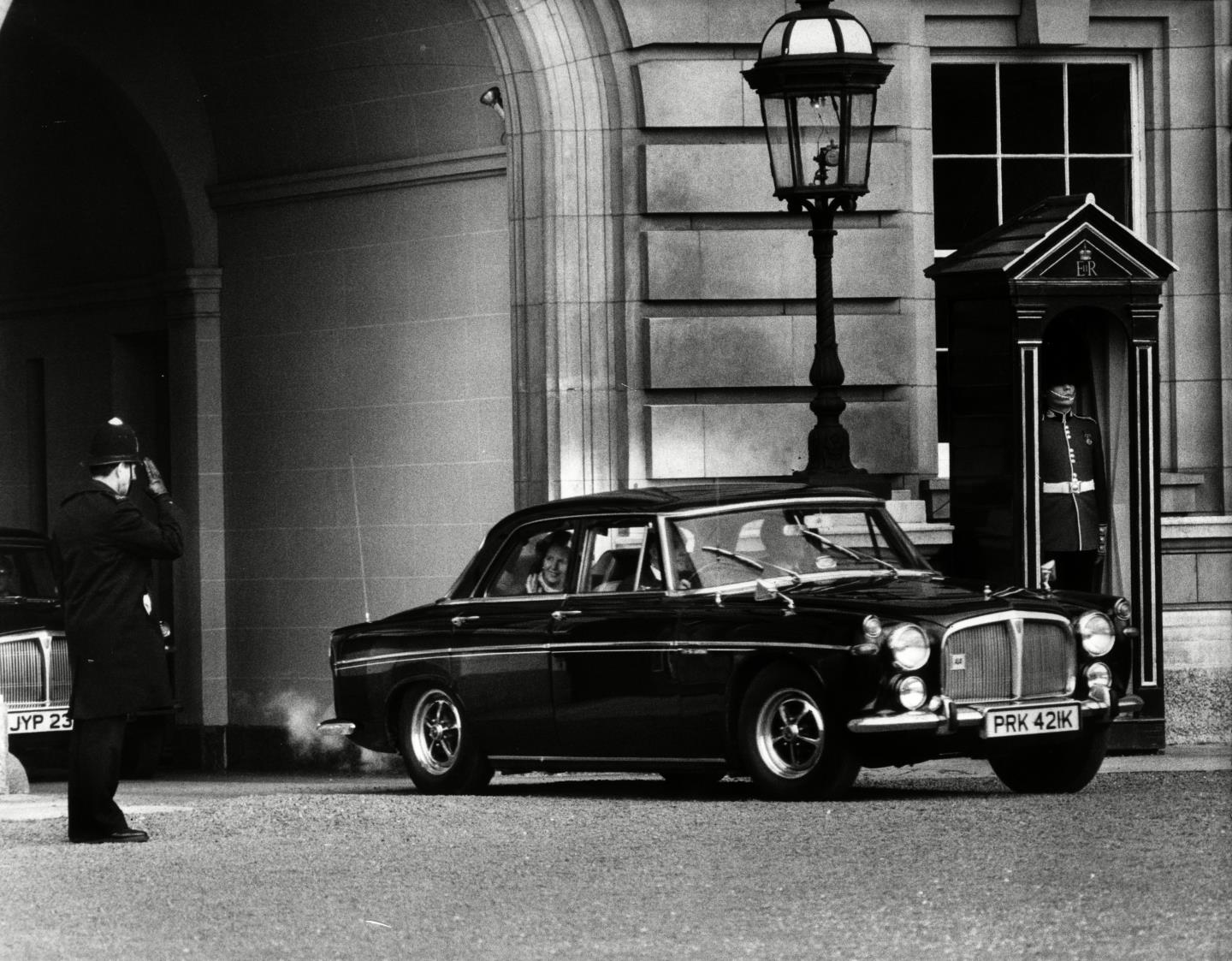 Margaret Thatcher leaves Buckingham Palace in May 1979 in her Rover, after becoming Britain's Prime Minister.