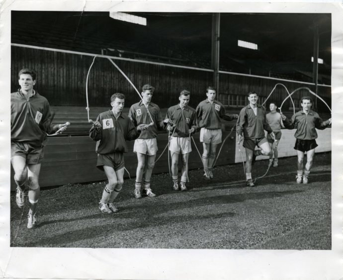 A group of St Johnstone players limbering up at Muirton Park ahead of their 1961 League Cup semi final in October 1961.