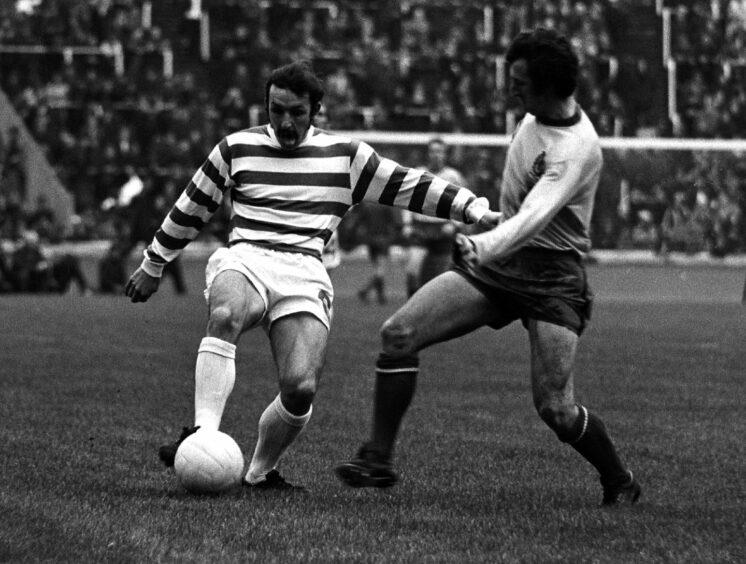 Celtic's Jim Brogan takes on Denis McQuade.