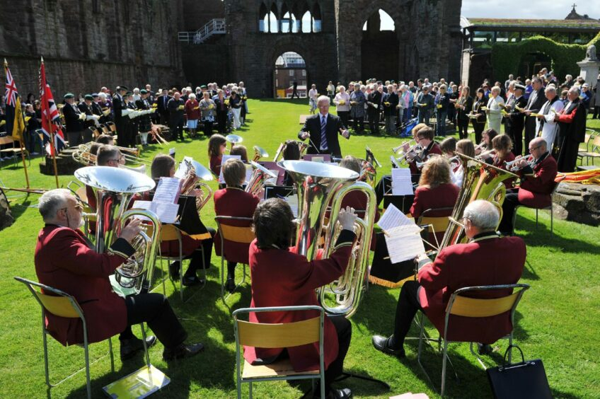 Arbroath Instrumental Band playing at a Queen's diamond jubilee event at Arbroath Abbey.
