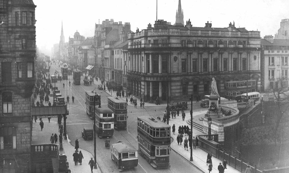 Trams move along with motorcars on Union Street in Aberdeen, around 1935. Photo: DCT Media