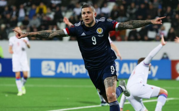 Lyndon Dykes celebrates his late winner for Scotland against the Faroes.