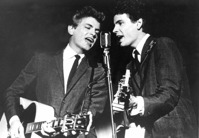 The Everly Brothers, Phil, left, and Don, perform on stage.