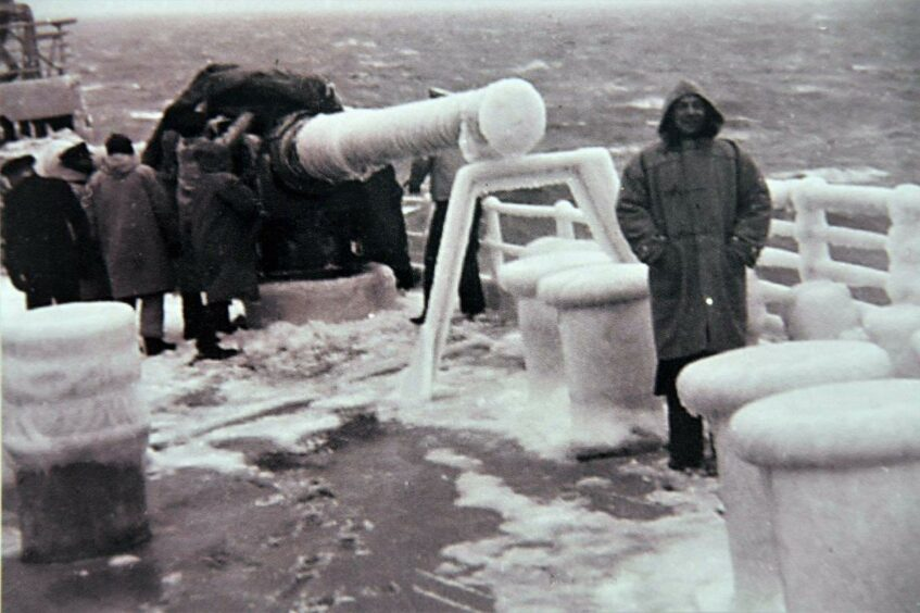 A man on the frozen deck of an Arctic convoy ship.