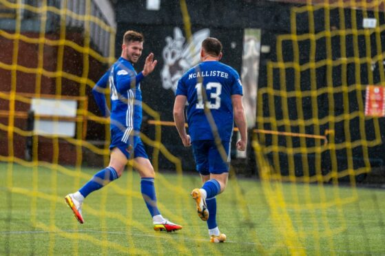 Cove Rangers substitute Jamie Masson congratulates Rory McAllister after setting up his second.