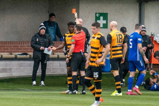 Mouhamed Niang is shown an early red card against Cove Rangers.