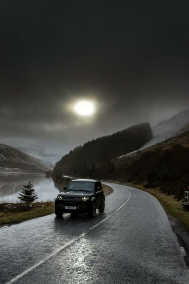 Land Rover Defender V8 with mountains in the background