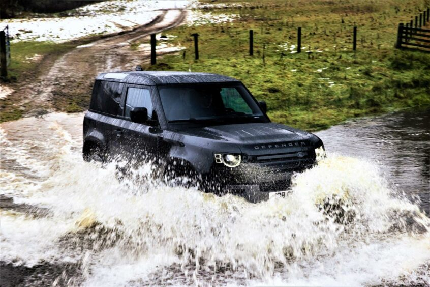 Land Rover Defender V8 off-road, going through water