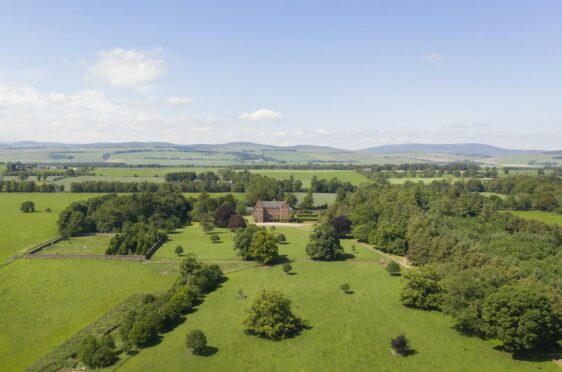 Aerial view of Careston Castle set in a large expanse of green countryside and woodland.