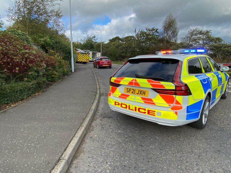 A police car blocking the B9149 in Lochgelly after a crash.