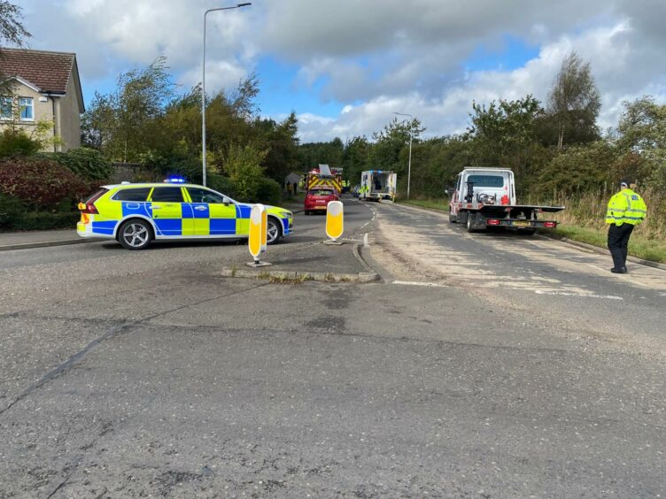 A police car, fire engine and ambulance on the B9149 in Lochgelly after a crash
