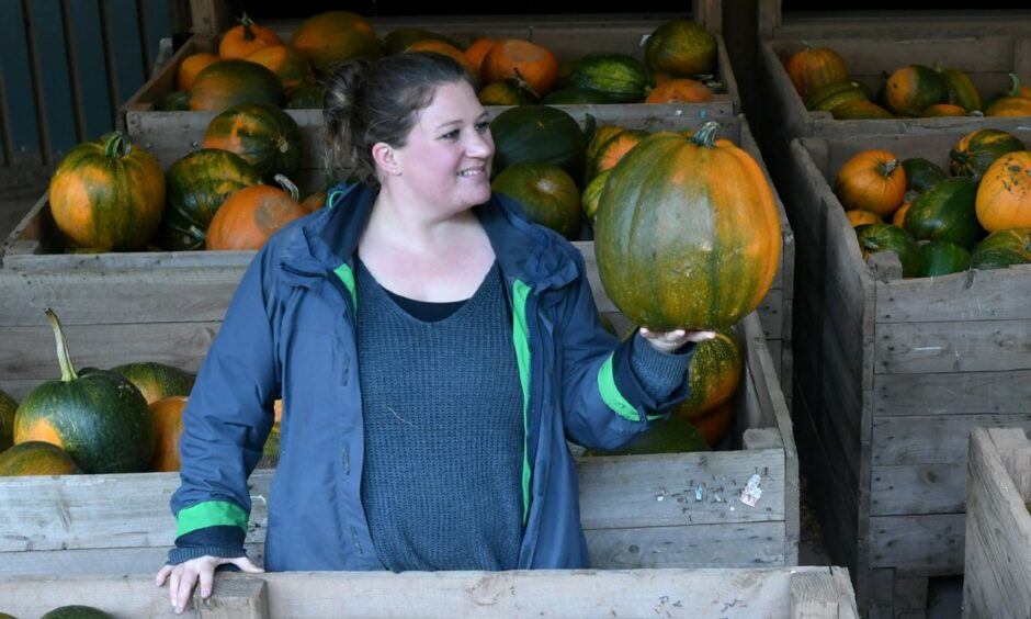 Fiona Smith pictured with some pumpkins.