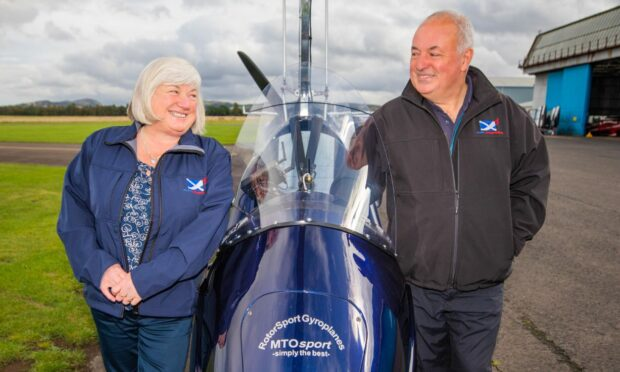 Elaine and Kevin Whitehead from Alba Airsports standing by a gyrocopter.