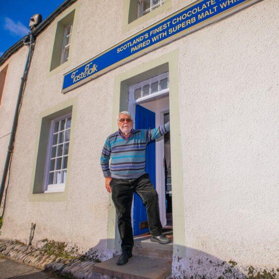 Peter outside the new premises on Dunkeld's High Street.