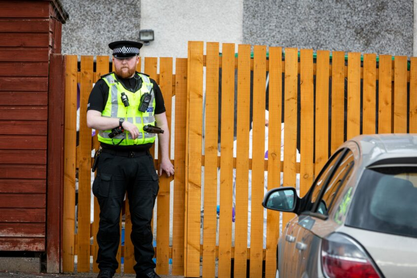 Police and Forensics officers at Colliston Avenue, Glenrothes.